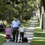 Alan Borsuk walks his grandchildren Estie Meister, 6, and her brother Dovid, 7, to their school in the Sherman Park neighborhood.  Photo by: Kristyna Wentz-Graff
